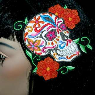 This headband is a huge Mexican Calavera Sugar Skull. It is covered in