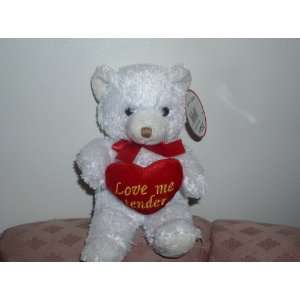LOVE ME TENDER MUSICAL TEDDY BEAR  Toys & Games