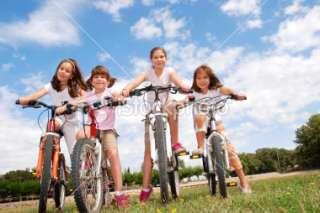 Four girls riding bikes Royalty Free Stock Photo